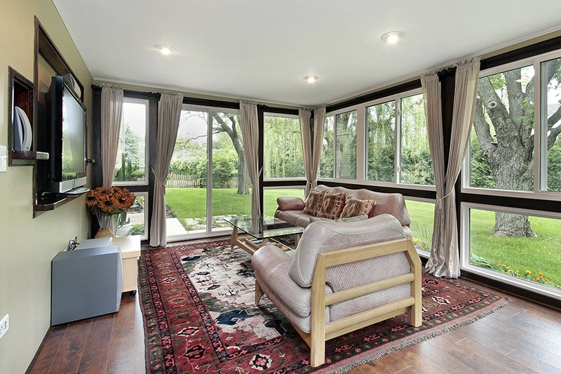 Sunroom in suburban home with outside view